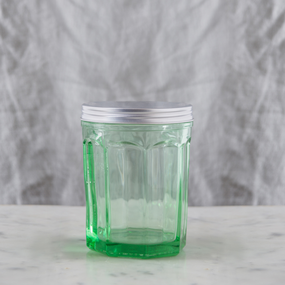 Pressed green glass storage jar with metal lid large