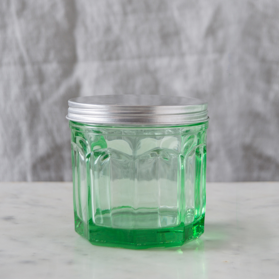 Pressed green glass storage jar with metal lid medium