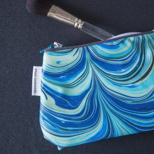 Aqua blue marble design washbag small Designers Guild