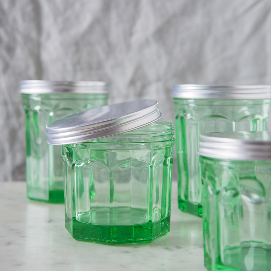 Pressed green glass storage jar with metal lid medium and large