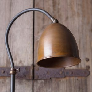Curved lamp with copper shade