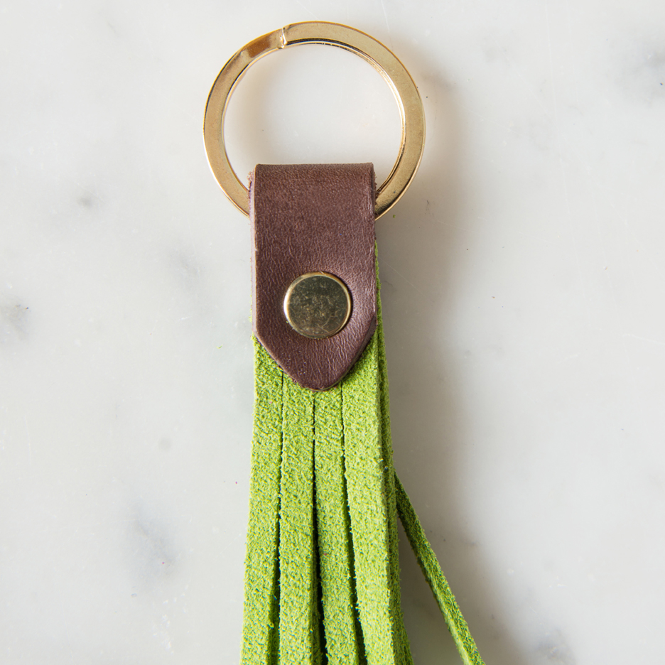 Suede and leather tassel key ring lime green