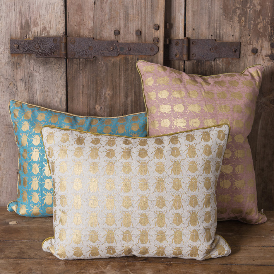 Gold beetle cushions