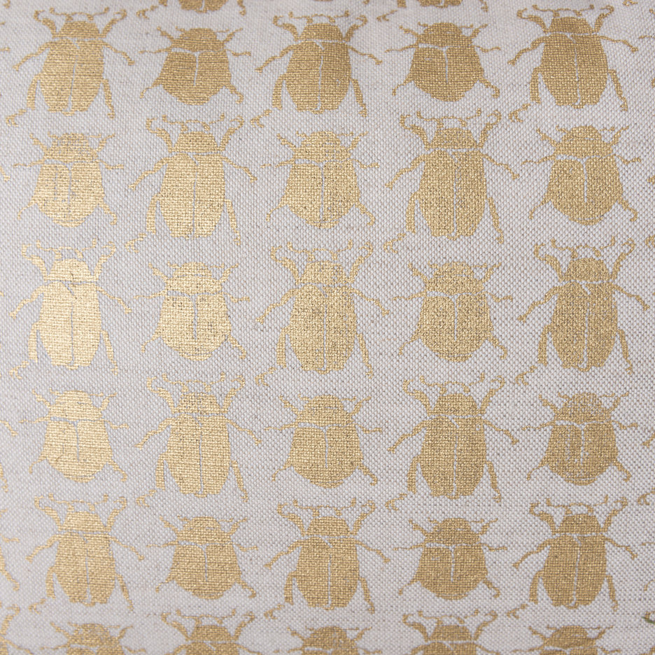 Ecru gold beetle cushion detail